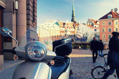 Scooter stands on the central square in Riga Stock Photos