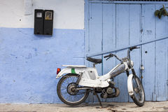 Scooter on Street in medina of blue town Chefchaouen, Morocco Royalty Free Stock Photo