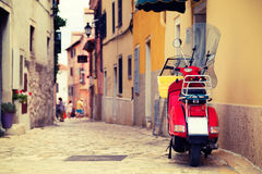 Scooter on the Street of Mediterranean Town Stock Photos
