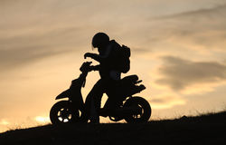 Scooter in the sunset. Scooter standing on a hill in the sunset Royalty Free Stock Photography
