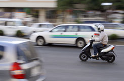 Scooter in traffic Stock Image