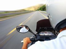 Scooter trip. Traveling on the highway at high speed scooter Royalty Free Stock Image
