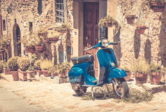 Scooter in Tuscany. Scooter in front of old building in Cortona town, Tuscany Stock Image