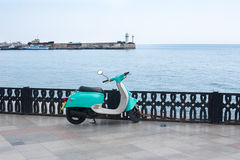 Scooter on waterfront Royalty Free Stock Image