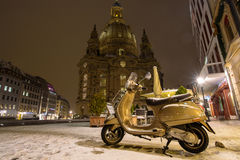 A scooter in the winter on the city streets of Europe, Germany, Dresden. royalty free stock photo