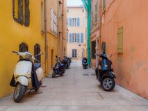 Scooters in an alley. stock image