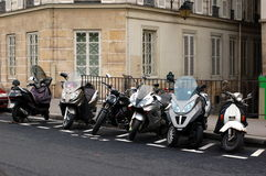 Scooters and bikes on Paris streets, France Stock Images