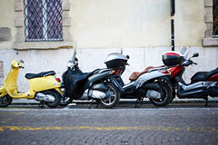 Scooters on the city street Stock Photo