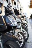Scooters on the city street Royalty Free Stock Photos