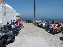 Scooters - good transport on the tiny island of the Cyclades Royalty Free Stock Image