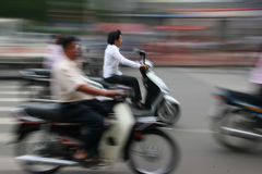 Scooters, Ho Chi Minh City. Scooters in Saigon rushing past Royalty Free Stock Photography