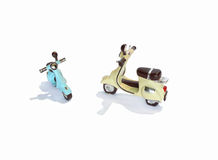 Scooters models. Two plastic small-scale models of old scooters Stock Image