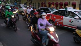 Scooters, mopeds, motorcycles, cars, traffic and people on the streets of Ho Chi Minh City, Vietnam. MOTORBIKES AND PEOPLE ON THE STREETS OF HO CHI MINH CITY OR stock video footage