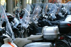 Scooters and mopeds with winter windshield parked in the city Royalty Free Stock Photography
