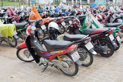 Scooters and Motor Bikes. Hue, Vietnam-October 18, 2009. Parking lot of Scooters and Motor Bikes in the central Vietnam city of Hue Royalty Free Stock Photography
