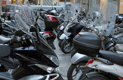 Scooters and motorcycles with windshields in winter parked Royalty Free Stock Photo