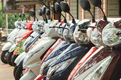 Scooters parked on a city street Stock Photos