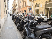 Scooters parked on a street in Rome Stock Photo