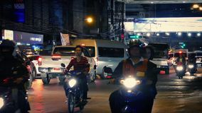 Scooters Passing On Main Road At Night. Many scooters passing by in evening city stock footage