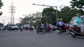 Scooters, cars, traffic, tourists, and people on the old quarter streets of the capital city, Hanoi, Vietnam. SCOOTERS AND PEOPLE ON THE STREETS OF HANOI stock footage