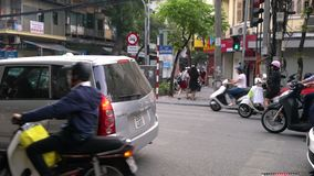 Traffic and people on pedestrian crossing in old quarter streets of the capital city, Hanoi, Vietnam stock video