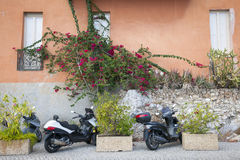 Scooters on street in Villefranche-sur-Mer Royalty Free Stock Photography