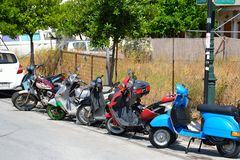 Scooterson street in Loutraki. Royalty Free Stock Image