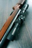 Scope mounted on a rifle. Closeup of a scope mounted on a rifle Stock Photo