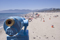 Scope on pier. Focusing on the beach Royalty Free Stock Photos