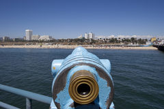 Scope on pier. Scope on the Santa Maonica pier pointing at Santa Monica Stock Photo