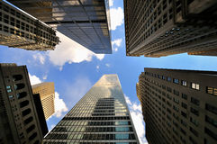 Scope to the sky and trigger. Bottom view of huge building in new york city Stock Photo