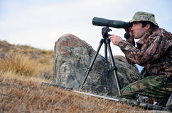 Scoping for game. Camoflaged hunter searching for Himalayan tahr in the Southern Alps of New Zealand Stock Images
