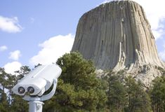 Scoping it out. Pair of binoculars that are at the base of Devils Tower Royalty Free Stock Photography