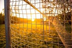 Scopo di calcio nell'alba 14 immagini stock