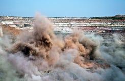 Scoppio in miniera a cielo aperto Immagini Stock