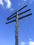 Scorched cable column with wires Royalty Free Stock Photos