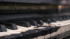 Scorched down to coal smoking piano keyboard