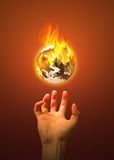 Scorched Earth. Conceptual photography featuring the planet on fire royalty free stock photos