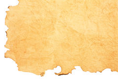 Scorched paper. Isolated beige scorched paper as a backround Stock Images