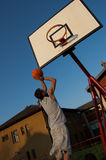 Score. Young basketball player scores two points Stock Image