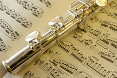 Score and flute. Flute on a sheet music Stock Photo