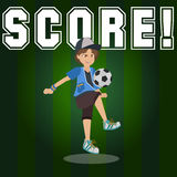 Score. Image of a little boy holding a soccer ball into the air Royalty Free Stock Photography