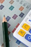 Score paper, calculator and pencil Royalty Free Stock Image