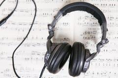 Score sheet and headphone Stock Photos