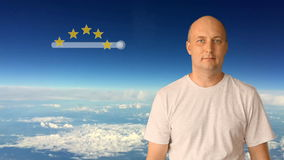 Score of 5 stars on a virtual screen. The man moves his finger on the virtual screen. Against a blue sky with clouds on. A sunny day. The white man shows stock footage