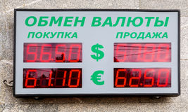 Scoreboard with currency exchange rate. Text in russian: Currenc. Samara, Russia - April 1, 2017: Scoreboard with currency exchange rate. Text in russian Royalty Free Stock Photos