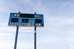 Scoreboard at Local Football Field With Copy Space. A tall electronic scoreboard at a local soccer cum football field against a blue sky with copy space Stock Photos