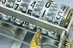 Scoreboard mechanism closeup. counter rolls with different numbe Royalty Free Stock Photo