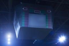 Scorebord en schijnwerpers Stock Foto's