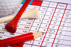 Scorecard with birdie. Golf scorecard with birdie marked with pencil, tees and golfball Royalty Free Stock Photos